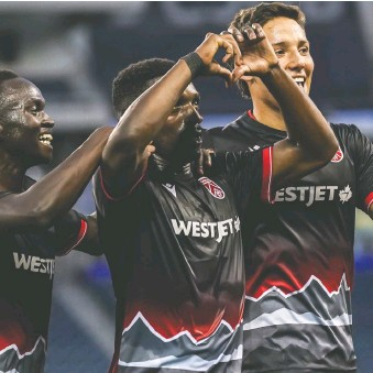 ?? ROBERT REYES, WILLIAM LUDWICK/CANADIAN PREMIER LEAGUE ?? Cavalry FC'S Ahinga Selemani, centre, celebrates with teammates after scoring his second goal of the match in a 4-1 victory over Atlético Ottawa in Winnipeg.