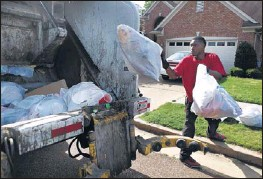 ??  ?? The City of Memphis contracts for private trash pick up in annexed areas such as Southeast Memphis, where J & J Waste employees including Tedrick Buford perform curbside collection.