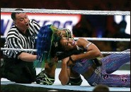 ??  ?? Sasha Banks, middle, and Bianca Belair turn in one of the fiercest matches of the night.