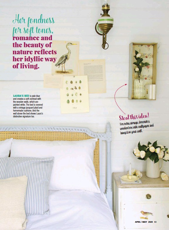 ??  ?? LAURA'S BED is pale blue and cre­ates a soft con­trast with the wooden walls, which are painted white. The bed is cov­ered with a vin­tage jacquard plaid and home­made cush­ions. And the wall above the bed shows Laura's dis­tinc­tive sig­na­ture too.