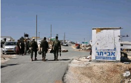 ?? (Marc Israel Sellem/The Jerusalem Post) ?? PEOPLE ENTER the Evyatar outpost.