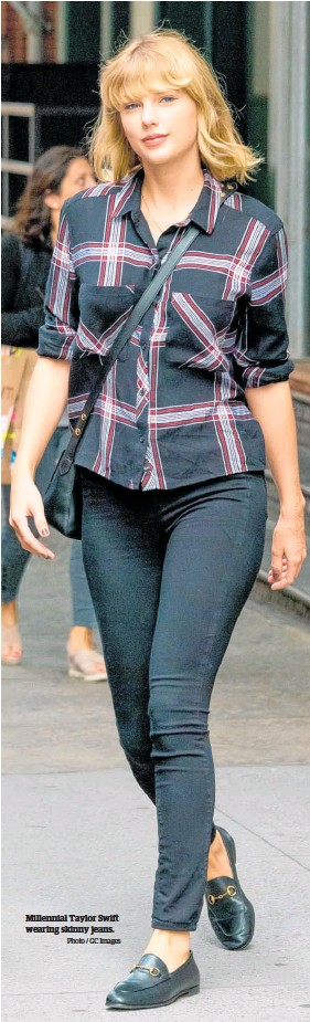 ?? Photo / GC Images ?? Millennial Taylor Swift wearing skinny jeans.