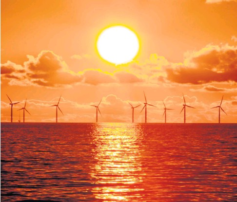 ??  ?? Sunset over the Walney offshore wind farm in Morecambe Bay in the North West. It is feared that a complex planning and licensing regime will delay the building of similar projects