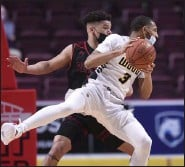 ?? BEN HASTY/MEDIANEWS GROUP ?? Archbishop Wood's Rahsool Diggins (3) and Reading High's Joey Chapman (5) battle for position Saturday in the PIAA 6A Boys Basketball State Championship Game at Hershey.