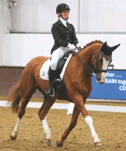 """??  ?? Marianne Fletcher and her """"opinionated"""" 10-year-old Hanoverian mare Hollandia secure the elementary honours for Cambridge RC"""