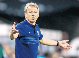 ?? Simon Hofmann Getty Images ?? U.S. COACH Juergen Klinsmann, shown at team's big win against Germany in June, will have a major hand in preparations for Olympic qualifying tournament.
