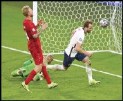 ?? Associated Press ?? PENALTY KICK England's Harry Kane, right, reacts after scoring his team's second goal during the Euro 2020 championship semifinal between England and Denmark at Wembley stadium in London on Wednesday.
