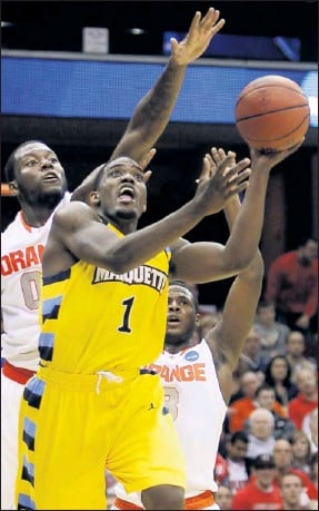 """?? By Tony Dejak, AP ?? Leading scorer: Guard Darius Johnson-Odomis one of five junior college transfers on Marquette's roster. His coach, Buzz Williams, says, """"I like guys that have had to ride in 15-passenger vans."""""""