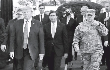 ?? PATRICK SEMANSKY/ASSOCIATED PRESS ?? President Donald Trump departs the White House on June 1, 2020, for a photo op outside St. John's Church, joined by advisers and U.S. officials, including Gen. Mark A. Milley, chairman of the Joint Chiefs of Staff, at right. Milley felt used in the situation, a new book reveals.