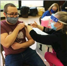 ?? EVAN BRANDT — MEDIANEWS GROUP ?? John Greiner of Harleysville gets a COVID-19vaccination shot from Liz Fulbright Friday at Bethel Community Church of Pottstown.