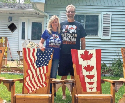 ?? PROVIDED BY KIM THOMPSON ?? Kim Thompson and boyfriend Art Malott in front of his home in Canada. They are frustrated that the United States has not opened the border so that Malott can drive to Detroit to visit Thompson in Ferndale, Mich.