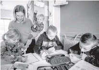 ?? AP ?? ONE year into the coronavirus pandemic, Katja Heimann is still trying to keep her spirits up—despite several lockdowns and months of teaching seven of her children in home schooling.