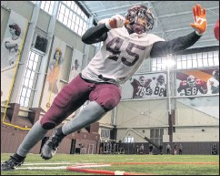?? DAVE KNACHEL/VIRGINIA TECH ?? Defensive end TyJuan Garbutt has found a new appreciation for football this spring after sitting out much of last season for personal reasons.