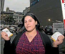 ?? SIMON MAUDE /STUFF ?? Nuha Marmachi, in Auckland in 2016, is one of many caught out by Wilson Parking's $65 fine for overstaying. She was less than 30 minutes late.