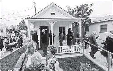 """?? Photographs by Luis Sinco Los Angeles Times ?? SANTA MONICA residents gather at a """"shotgun"""" house that had been slated for demolition but which is now the Santa Monica Conservancy's Preservation Resource Center. The structure probably dates to the 1890s."""