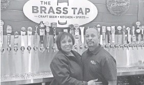 ??  ?? Sharon and Mark Ripley are owners of The Brass Tap, a craft beer-themed restaurant in Oxon Hill, Md. MIKE SNIDER/USA TODAY
