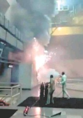 ?? U. SUBRAMANYAM ■ ?? Frantic fight: Fire raging in the control panel of Srisailam powerhouse in Telangana on Friday.