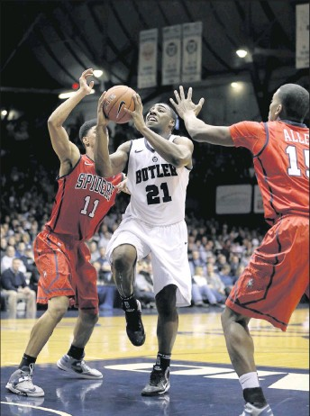 """?? 2013, THE ASSOCIATED PRESS ?? Butler's Roosevelt Jones shot between UR's Deion Taylor ( left) and Terry Allen at historic Hinkle Fieldhouse in 2013. The Spiders faced the Bulldogs in the gym where the final scenes of themovie """"Hoosiers"""" were shot."""