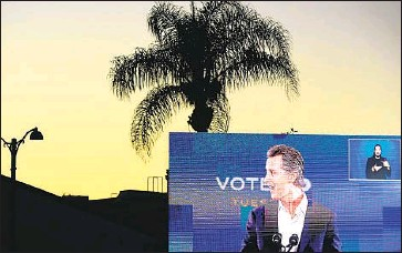 ?? Wally Skalij Los Angeles Times ?? GOV. GAVIN NEWSOM won the election by a large margin, a victory that provides him with a mandate to continue pursuing liberal policies on issues such as healthcare, climate change and immigration.