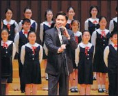 ?? Right: PHOTOS PROVIDED TO CHINA DAILY ?? Left: Conductor Yang Li, who will perform in the anniversary concerts, at a show with a children's choir in the Forbidden City Concert Hall in January. Zheng Jian, artistic director of the Tianjin Song and Dance Theater, conducts at the December concert.