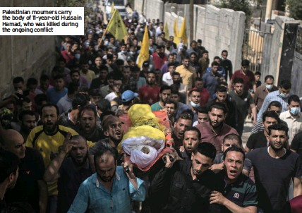 ??  ?? Palestinian mourners carry the body of 11-year-old Hussain Hamad, who was killed during the ongoing conflict