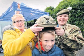 ??  ?? Newest recruit May Atkinson, left, with her grandson Alasdair Aitken and Pte Shauni Lennox of 6 Scots