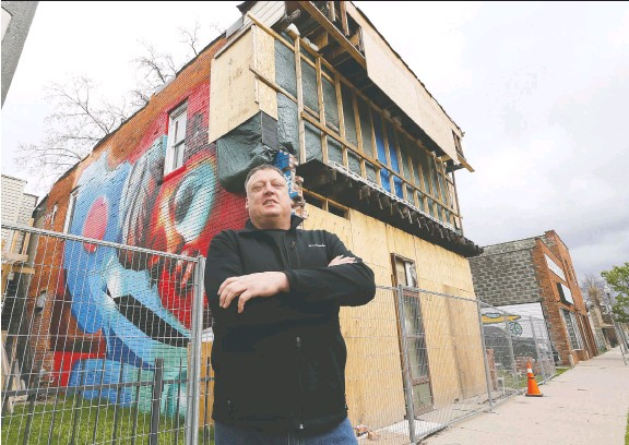 ?? DAN JANISSE ?? Randy Diestelmann stands in front of the Drouillard Avenue building he is renovating. He has applied to a city program that offers building improvement incentives.