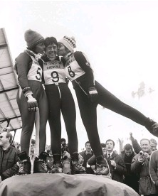 ??  ?? FROM LEFT: Greene points to Sun Peaks' OSV run, part of the Nancy Greene International Race Center at the resort; a young Nancy Greene (center) poses with fellow racers Annie Famose (left) and Fernande Bochatay (right) after winning Olympic Gold in giant slalom at the 1968 Grenoble Winter Games.