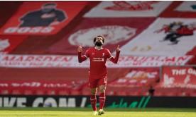 ?? Photograph: Jon Super/NMC Pool/The Observer ?? Mohamed Salah celebrates his equaliser.