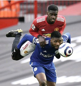 ?? GETTY IMAGES ?? LIFT-OFF: Kelechi Iheanacho tries to shield the ball from Axel Tuanzebe