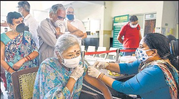 ??  ?? A medic administers COVID-19 vaccine to an eldery citizen during a vaccination drive in Gurugram on Thursday.