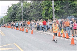 ?? JOE GIBBONS/THE TELEGRAM ?? People line up for Chase the Ace tickets in Goulds on Wednesday.