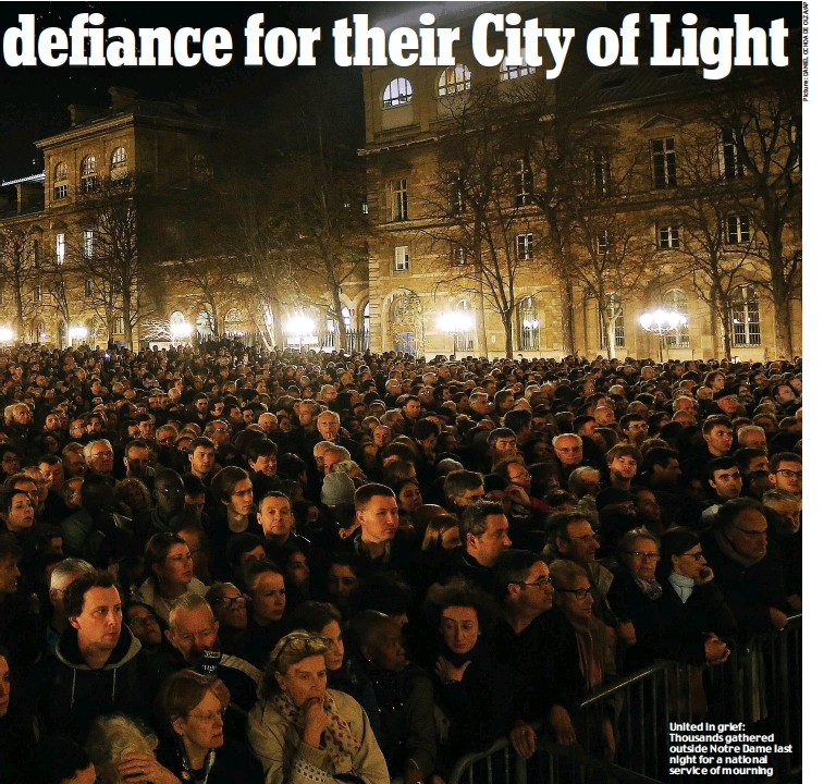??  ?? United in grief: Thousands gathered outside Notre Dame last night for a national service of mourning