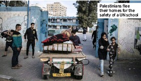 ??  ?? Palestinians flee their homes for the safety of a UN school
