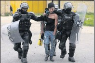 ?? THE ASSOCIATED PRESS ?? Police detained a protester in Gachancipa, Colombia, on Friday. President Ivan Duque withdrew a tax plan, but unrest continues.