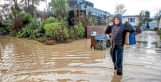 ?? PHOTO: JOHN KIRK-ANDERSON/STUFF ?? Andre Maasjosthusmann returns to his Riverlaw Tce home in St Martin, Christchurch, yesterday after the Heathcote River's floodwaters retreated sufficiently.