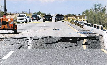?? Photographs by Don Bartletti Los Angeles Times ?? CALIFORNIA HIGHWAY PATROL vehicles block a section of Interstate 10 between Coachella and the Arizona border where Sunday's unusual rainfall caused a bridge to collapse over a desert wash.