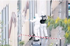 ??  ?? PROBE: Forensic experts investigate the scene of an incident near the former offices of French magazine 'Charlie Hebdo' on Friday.