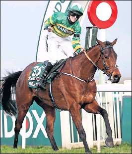 ??  ?? Rachael Blackmore crosses the line on Minella Times to become the first female jockey to win the Randox Grand National