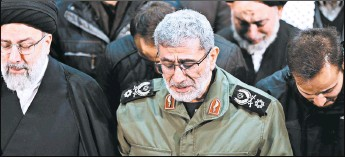 ?? OFFICE OF THE IRANIAN SUPREME LEADER ?? Gen. Esmail Ghaani, head of Iran's Revolutionary Guard's Quds Force, weeps as he prays over the coffin of Gen. Qassem Soleimani on Jan. 6 in Tehran, Iran.