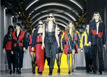 ??  ?? Models make the final walk down the runway during a show by designer Julia Postushna at the Ukrainian Fashion Week in Kyiv on Feb. 7, 2021. Because of the pandemic, the industry's main event had no live audience and streamed its presentations online.