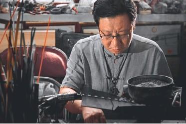 ??  ?? Liu Yu dans son atelier