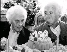 ?? Herald Archive, Reuters ?? Marie Hendrix, left, and Gabrielle Vaudremer, 100-year-old identical twins, celebrate their birthday at the Chateau Sous-Bois retirement home in Spa, Belgium, last fall. Reader says twins already know what science wastes time and money to learn about...