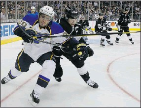?? — MCT ?? The St. Louis Blues' Alexander Steen (left) battles for the puck with Dustin Brown of the Los Angeles Kings during Game 3 of the Western Conference semifinal at Staples Center in L.A.