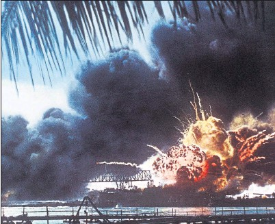 ??  ?? DESTROYED: The USS Shaw explodes after being hit during the attack on Pearl Harbour. Pictures: Sipa Press/REX/Shutterstock.