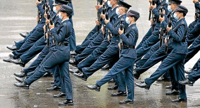 ?? AP ?? Hong Kong police show their new goose-step marching style on the National Security Education Day at a police school in Hong Kong.