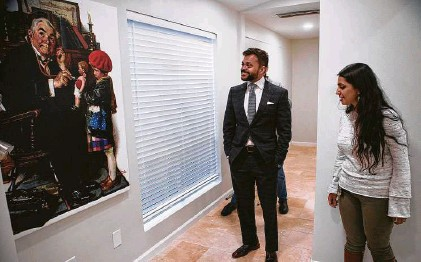 """?? Brett Coomer / Staff photographer ?? Swapnil Agarwal, CEO of Nitya Capital, left, and Deepika Agarwal tour the new clinic in the Bella Vista apartments earlier this month. Nitya Capital is adding a clinic to the apartment complex, which will be """"completely free"""" for renters."""
