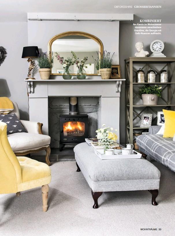 ??  ?? KOMBINIERT Am Kamin im Wohnzimmer dominieren verschiedene Grautöne, die Georgia mit Gelb-Nuancen auffrischt.
