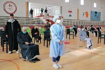 ?? | REUTERS ?? PEOPLE wait to receive the Covid-19 vaccine, during a national vaccination campaign, in Sale, Morocco.