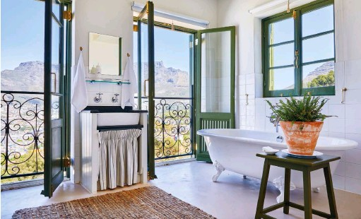 ??  ?? CLOCKWISE FROM ABOVE The spectacular view of Table Mountain from The Moon family suite; the Rose House bathroom features a Hydrofire wood-burning fireplace; The Moon suite's kitchen with distressed tile blocks that were found at a local tile shop.